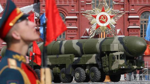 A Russian Topol-M ICBM drives across Red