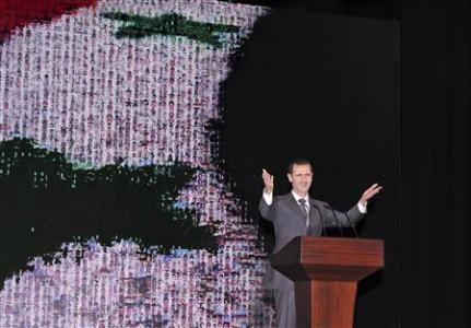 Syria's President Bashar al-Assad speaks at the Opera House in Damascus
