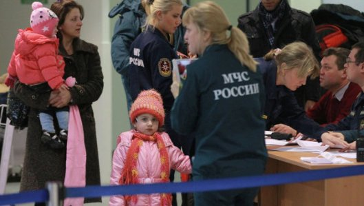 Russos evacuados da Siria